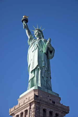 Statue of Liberty complete blue sky background Stock Photo