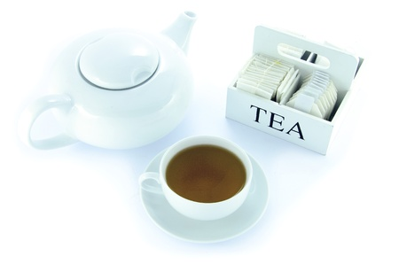 Teapot and teacup with a set of tea bags photo