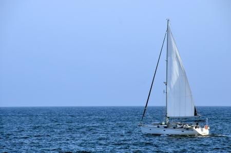 Lonely sailboat in a beautiful blue sea