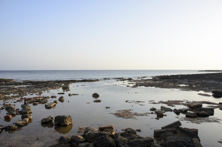 Stones and sea sunset lights