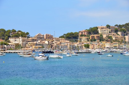 Mediterranean seaport, sailboats, yatchs, sean and the village in a blue day 免版税图像