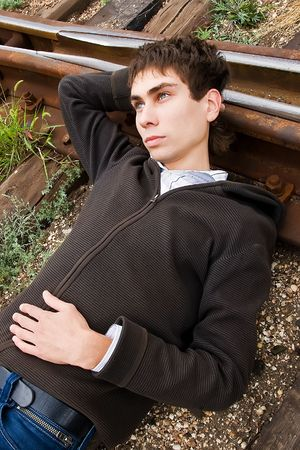 Young man laying on a railway tracks Stock Photo - 5647493