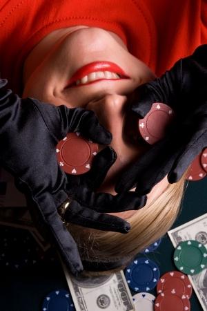 gambler: Blond gambler having fun with poker chips