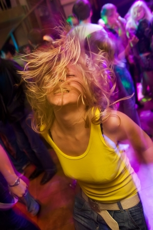 Blond girl partying in the nightclub photo