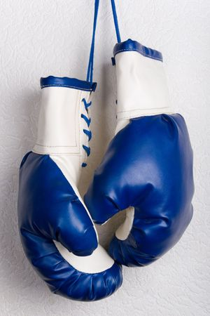 blue gloves: White and blue boxing gloves Stock Photo