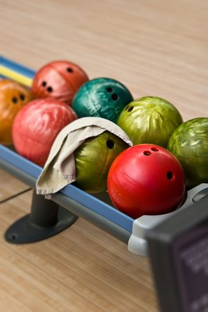 Balls for bowling on a shelf photo