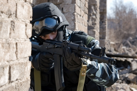 tactical: Soldier with a rifle targeting Stock Photo