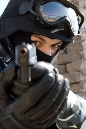 airsoft gun: Soldier with a semi-automatic glock pistol targeting  Stock Photo