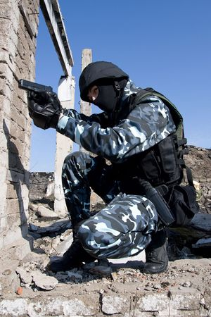 airsoft: Armed officer aiming the target with 9mm semi-automatic pistol