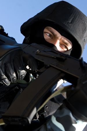 Portrait of a soldier with automatic russian AK-47 rifle photo