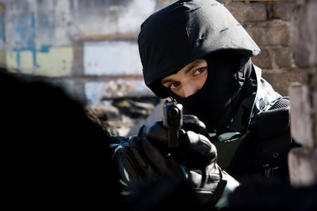 Soldier targeting with a 9mm glock pistol photo