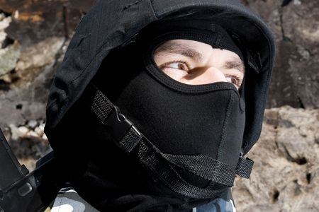 Potrait of a soldier in mask and tactical helmet photo
