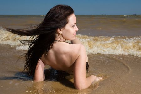 chilling: Attractive white woman chilling at the seaside