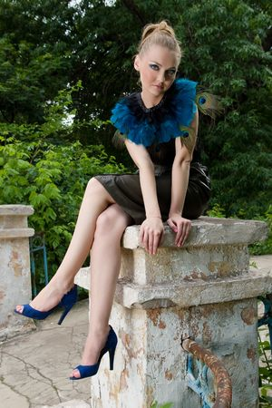 Fashionable chick posing outdoors photo