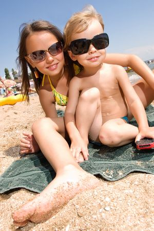 Small brother and sister spending their vacation at the summer resort Stock Photo