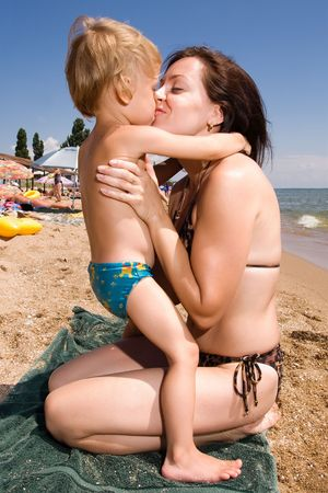 Mom and her child at the beach photo