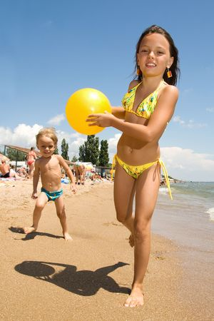 guy on beach: Small brother and sister spending their vacation at the summer resort Stock Photo