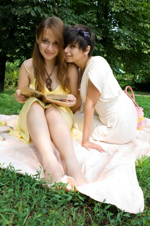 coverlet: Couple of girls spending their free time outdoors