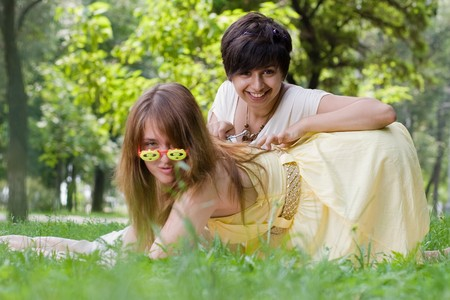 coverlet: Couple of late teenage girls having fun in the park