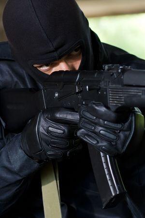 trooper: Trooper in black mask targeting with a gun