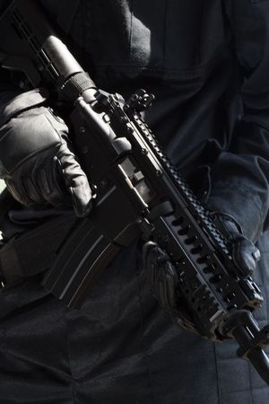 tactical: Closeup of an automatic M-4 rifle
