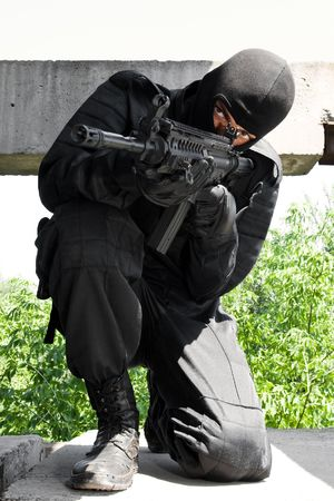 gunner: Terrorist aiming his target with a gun standing on his knee