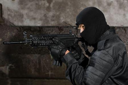 targeting: Terrorist in black uniform targeting with M-4 rifle