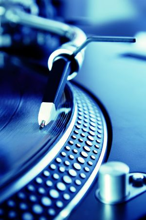 Vinyl record player spinning the disc photo