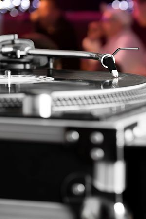 remix: Professional analog djing equipment playing the music at the party Stock Photo
