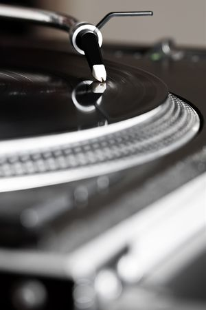 Professional analog djing equipment playing the music photo