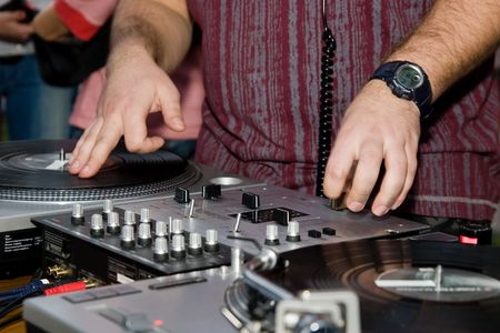 crossfader: Man playing rap music records in the club