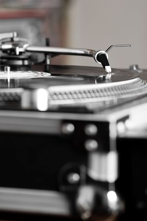 Professional analog djing equipment playing the music photo