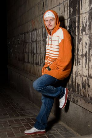 Smiling young rapper guy outdoors at night photo
