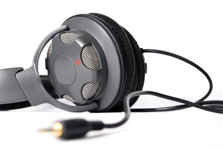 minijack: Pair of closed powerful stereo headphones on white background