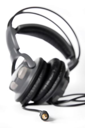 stereo cut: Pair of closed powerful stereo headphones on white background