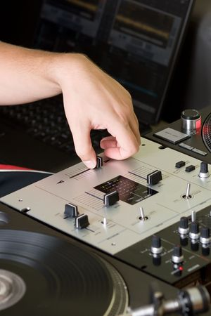 Hand of a disc jockey on the professional mixing controller Stock Photo - 7924823