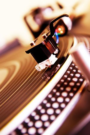 Record player spinning the disc with music photo