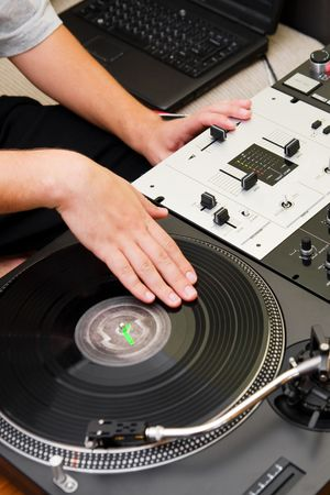 crossfader: Hands of a dj playing hip-hop Stock Photo