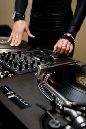 crossfader: Chick spinning the vinyl records in the nightclub