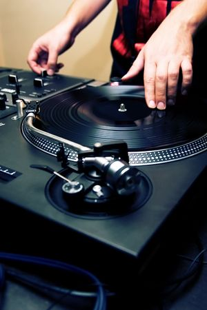 crossfader: Guy playing rap music records in the club Stock Photo