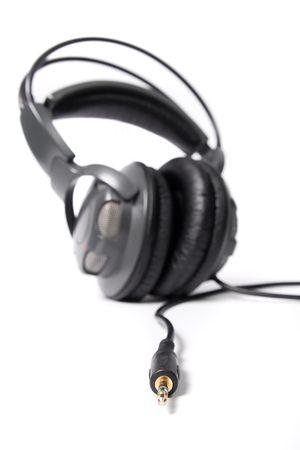minijack: Pair of closed powerful stereo headphones on white background