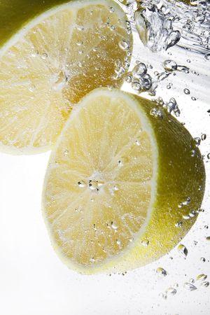 Couple of fresh juicy lemons under water on white background Stock Photo - 8207050