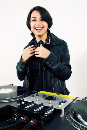Young attractive teenage girl playing music from vinyl photo