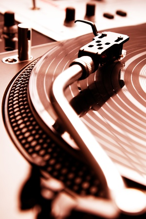 Analog turntable playing record with music photo