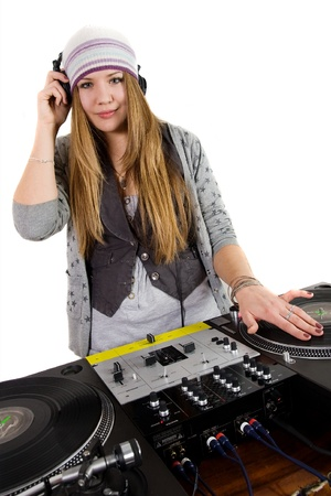 Young female hip-hop dj playing photo