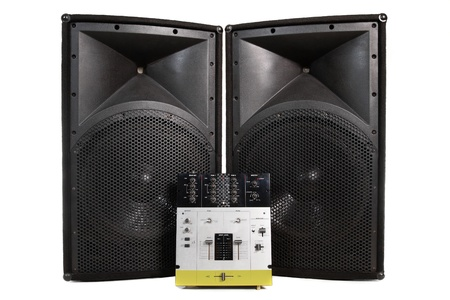Speakers and professional mixing controller for a disc jockey photo