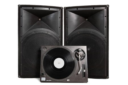 Professional vinyl record player with two large speakers on white background