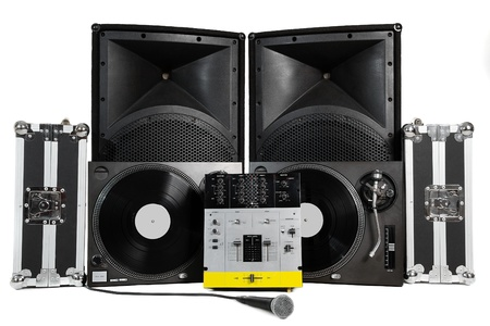 Travel cases, turntables, professional mixing controller, vocal microphone and speakers on white background
