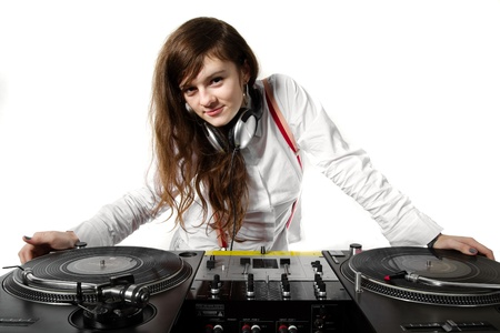 Attractive young chick playing music from vinyl records (isolated on white background) photo