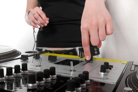 Girl puts hear finger on a fader of professional audio mixing controller photo